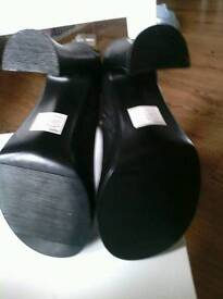 Ladies black heeled boots by Raid