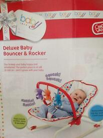 As new chad valley baby bouncer & rocker