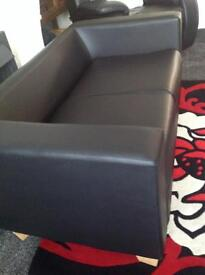 Two seater sofa in good condition .