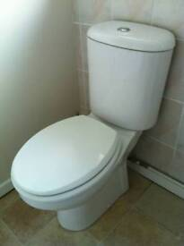 White low flush toilet and cistern