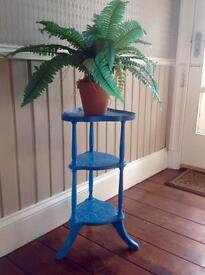 A one-off corner, three tiered display table or plant stand