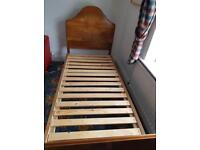 Single wooden bed and mattress