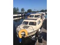 22 foot cabin cruiser with Honda outboard engine