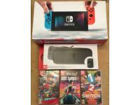 Nintendo switch + case + 3 games