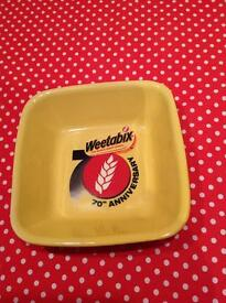Weetabix 70th anniversary square yellow bowl.