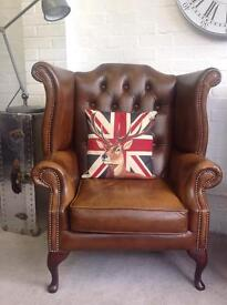 Wing back Queen Anne tan Chesterfield armchair. Can deliver