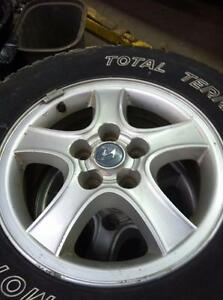 "4 - Hyundai Sante Fe 16"" Alloy Rims (5X114.3) with Excellent Motomaster Total Terrain Tires - 225/70 R16"