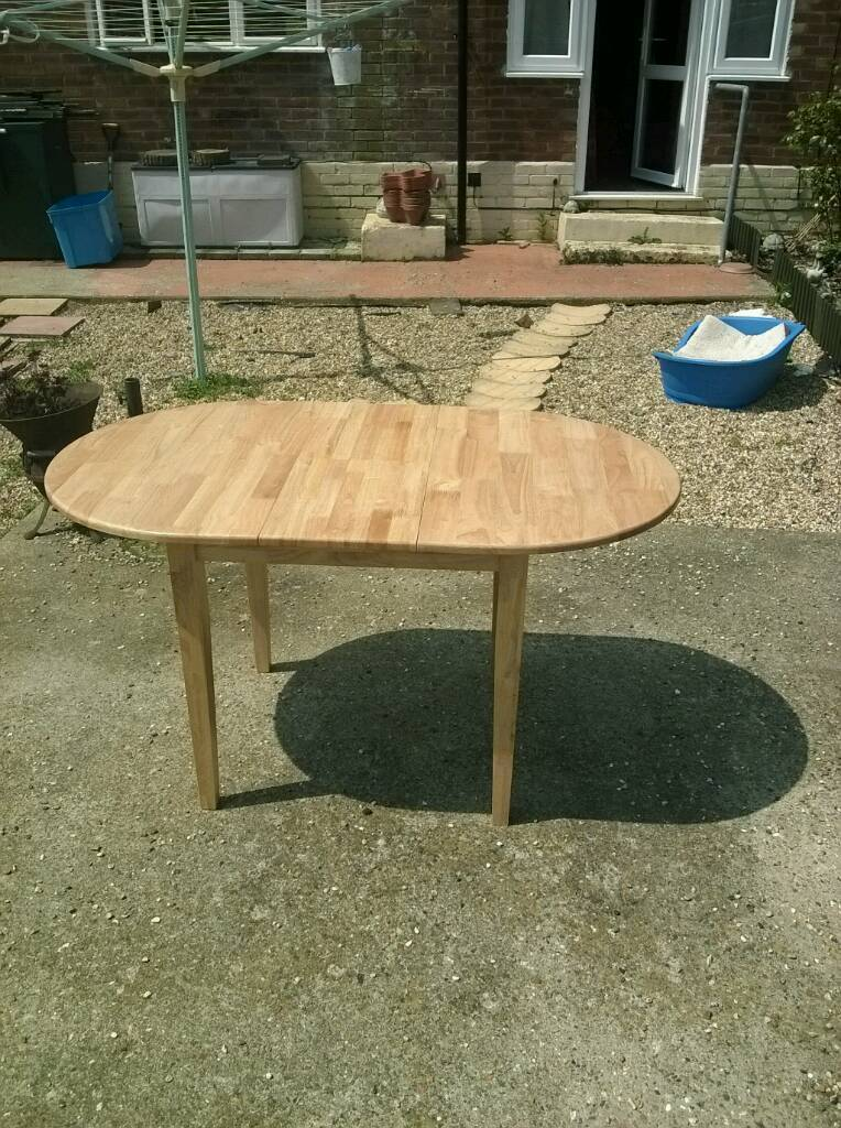 SOLID PINE OVAL EXTENDING DINING TABLE