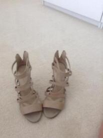 Ladies size 5 stiletto heeled worn sandals
