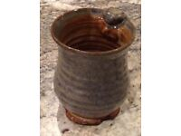Art studio pottery cup with potters stamps