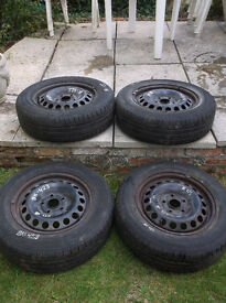 Four wheels with tyres from a VW Golf 2005