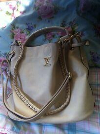 Louis Vuitton style designer handbag beige