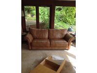 Leather sofa large two seater from reids. Soft caramel colour