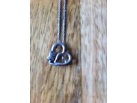 """Beautiful double heart & cubic zirconium kiss. 18"""" delicate rope chain. Sterling silver."""