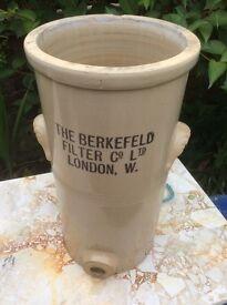 Tall thin old water filter jar