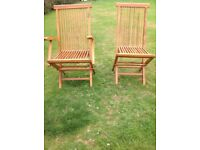 Wooden garden chairs with cushions