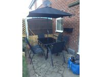 8 piece patio set glass top with wind up and down sun shade.
