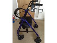 Four wheel rollator ( walking aid with seat)