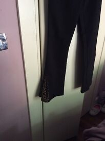 Ladies blk flared trousers leopard inserts
