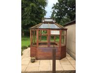 Robust wooden greenhouse / potting shed - double height shelving