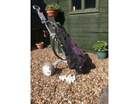 Set of golf clubs plus bag and trolley