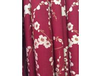 Full length Laura Ashley made to measure curtains with gold curtain rod and tie backs