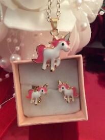 Unicorn earring and drop on a chain.