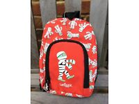 A cute, red Smiggle mini backpack with pencil holder inside, perfect for journeys