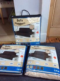 Beige fabric sofa huggers. Brand new still in packet. Covers for a 3 seater sofa & 2 armchairs