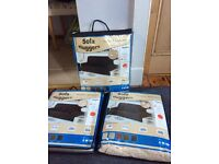 Beige fabric sofa hungers. Brand new still in packet. Covers for a 3 seater sofa & 2 armchairs