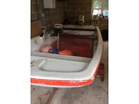 12ft boat with 35Hp engine and trailer