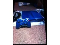 Limited edition blue xbox 360 console with pad and over 40 games mostly Fifa and Pes and Lego games.