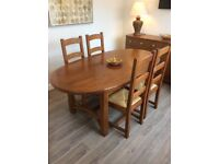 Solid oak extending dining table with 4 chairs