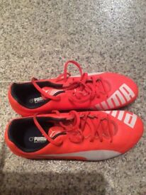 Orange puma football boots size 7