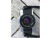 Canon AV1 camera and Sunpak flash gun