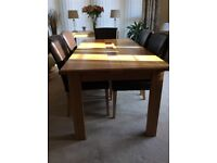 Solid oak dining table & 6 lace back leather chairs