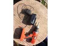 Black and decker drill 18v battery and a charger