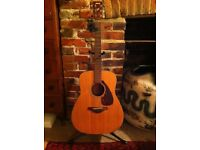 Yahama acoustic guitar, right handed, steel strung