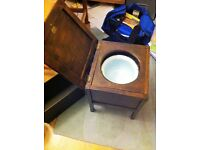 Old fashioned commode. Once held holy water.