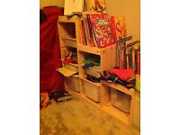Child's storage unit with sliding trays