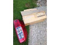 Nissan Navara D40 genuine new RH tail lamp assembly