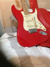 Red Rockburn Stratocaster type electric guitar