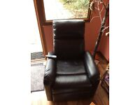 Two black massage chairs