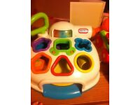 Selection of baby toys, vtec car wheel, little tikes shape finder , happyland. Range in price