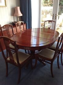Rosewood Extending circular dining table with 6 chairs