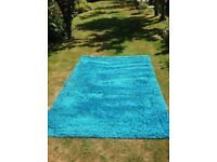 Turquoise rug for sale, excellent condition, hardly used.