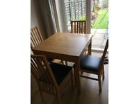 Extendable Oak Dining table with matching chairs