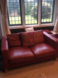 Red leather two seater sofa, great condition. Width 1500mm x Depth 900mm . Pick up only Leeds 18