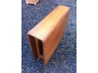 Vintage teak mid century modern Danish designed drop leaf table