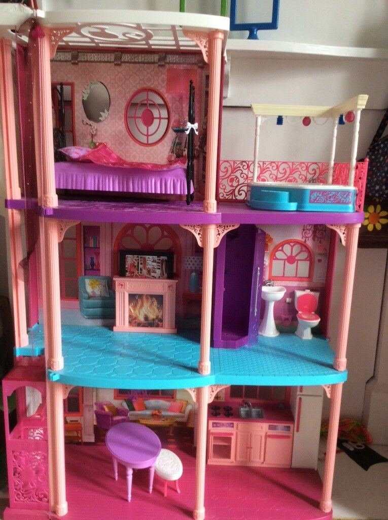 Barbie Dream House with lots of play features, including tons of accessories H110cm W77cm D32cm